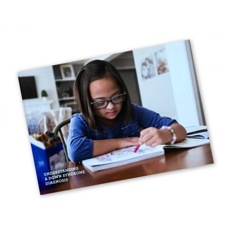 Photo of book with young girl with Down syndrome on the cover.